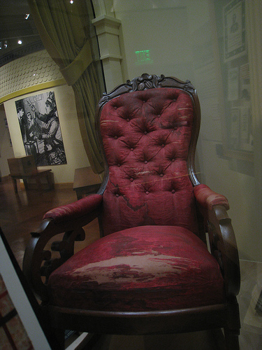 Bloodstains and all, the chair in which Abraham Lincoln was assassinated resides in the Henry Ford Museum in Dearborn, Mich.